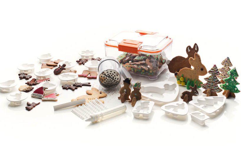 Modeli za piškote, pisalo za okraševanje, posoda za shranjevanje piškotov in univerzalni ribež Status.