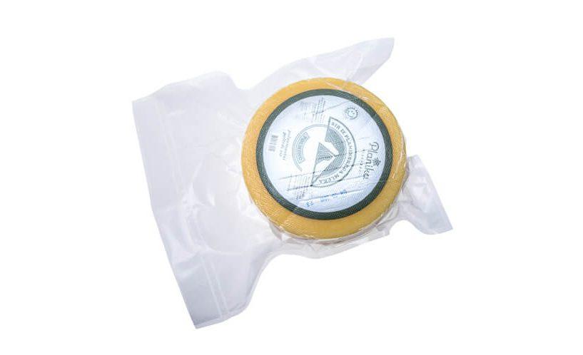 Kolut sira zavakuumiran v XL vrečko za vakuumiranje Status.