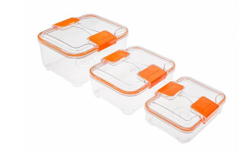 Status lock posode v 3-delnem setu v oranžni barvi na belem ozadju.